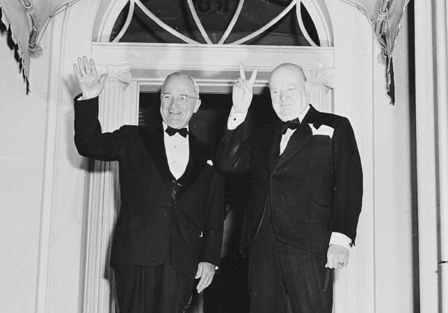 US President Harry S. Truman and UK Prime Minister Winston Churchill doing the V Sign