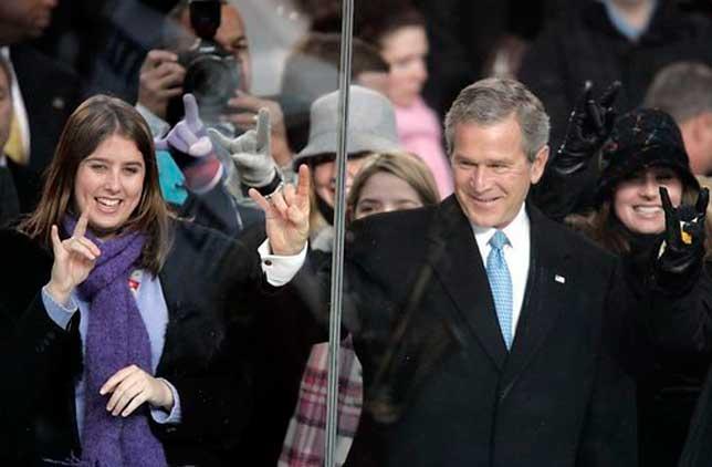 GW Bush doing the Hook 'em Horns sign