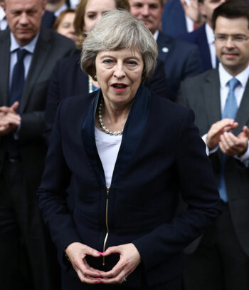 illuminati hand sign theresa may reversed pyramid